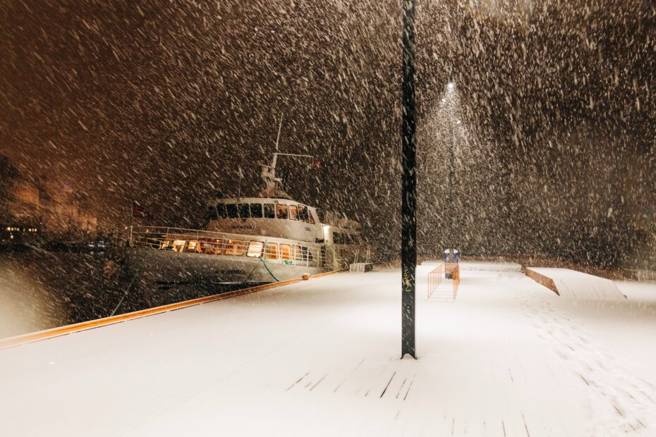 white boat beside port